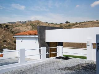 RESIDENCIA ROSELLA Garajes modernos de Excelencia en Diseño Moderno