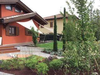giardino privato Giardino in stile rustico di I Giardini di Anna Rustico