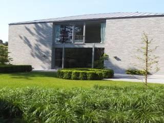 Exemples de realisations: Maisons de style  par Art and Landscape
