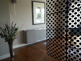 Modern black room dividers in fancy hexagon geometric pattern:  Household by Lace Furniture