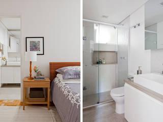 Apartamento da Cláudia e do Daniel: Banheiros  por INÁ Arquitetura,Eclético