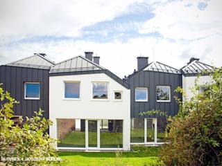 BUDYNEK 4-RODZINNY KURÓW Nowoczesne domy od GÓRSKI CHMIELEWSKA ARCHITEKCI Nowoczesny