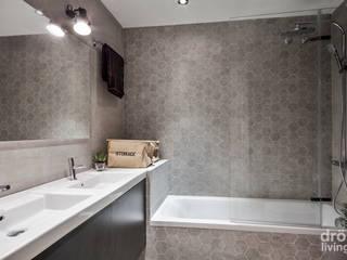 Casas de banho minimalistas por Dröm Living Minimalista