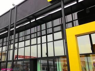 Facciata vetrata Centri commerciali in stile industrial di Modula Group Srl Industrial