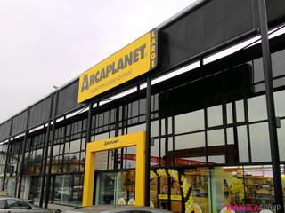 Facciata vetrata Negozi & Locali commerciali in stile industrial di Modula Group Srl Industrial