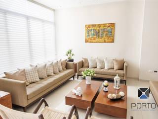 Salas de estar ecléticas por PORTO Arquitectura + Diseño de Interiores Eclético