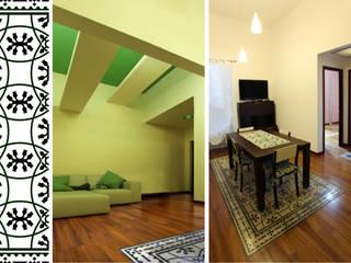 Appartamento DC - riqualificazione architettonica di piccoli spazi abitativi: Ingresso & Corridoio in stile  di studioIDEAM