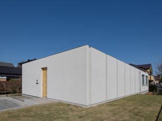 Casas de estilo  por アトリエ24一級建築士事務所