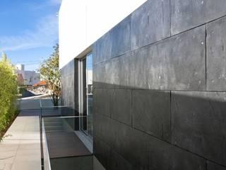 A.F. House Atelier d'Arquitetura Lopes da Costa Nowoczesne domy Łupek Szary