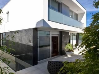 A.F. House Balcones y terrazas de estilo moderno de Atelier d'Arquitetura Lopes da Costa Moderno