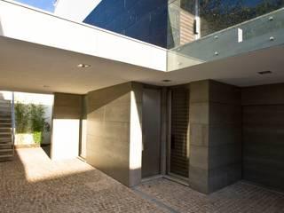 Casa A.F.: Casas  por Atelier Lopes da Costa,Moderno
