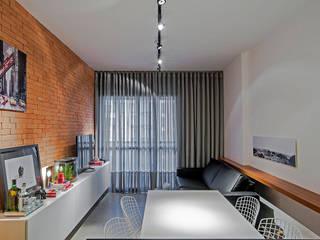 Modern dining room by Studio Boscardin.Corsi Arquitetura Modern