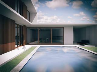 Casa na Charneca da Caparica: Casas  por Tapada arquitectos,Moderno