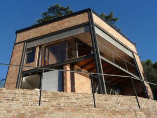 Casa Aity: Casas de estilo rústico por Arcubo arquitectos