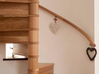 TIMBER SPIRAL STAIRCASE:  Corridor & hallway by Haldane UK