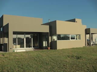Casas de estilo minimalista de JORGELINA ALVAREZ I arquitecta I Minimalista