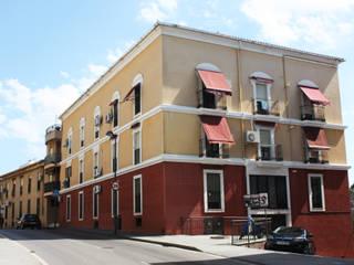 Rehabilitación de Fábrica de Harina para viviendas y garajes Casas de estilo rústico de Sánchez Terio Arquitectos Rústico