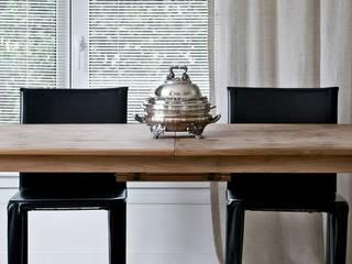 Modern dining room by Arq. PAULA de ELIA & Asociados Modern