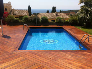 Modern pool by Quercus Jardiners Modern