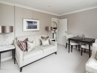 Loughton:  Living room by The White House Interiors