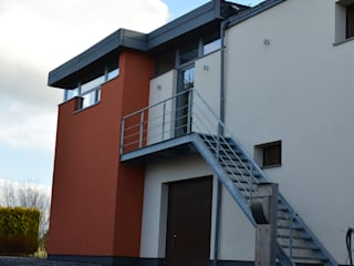 Transformation de bureaux et de combles en appartements Maisons modernes par DELTA Architects Belgique Moderne
