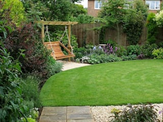 The new lawn and swing seat corner: country Garden by Jane Harries Garden Designs