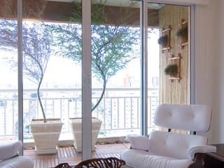 Apartamento para jovem rapaz Lucia Helena Bellini arquitetura e interiores Salas de estar modernas