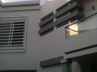 vista interior : Casas de estilo  por OROPEZA ARQUITECTOS