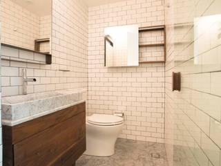 Casas de banho  por TW/A Architectural Group