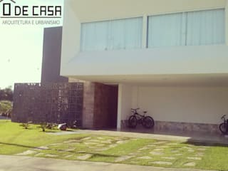 Alphaville litoral norte I Casas modernas por ô de casa - arquitetura e light design Moderno