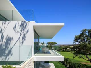 Vale do Lobo 1147: Casas  por JSH Algarve Arquitectura Lda,Minimalista
