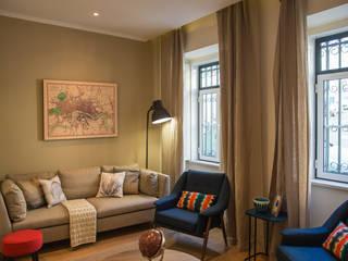 Um look contemporâneo e cosmopolita Architect Your Home Salas de estar modernas