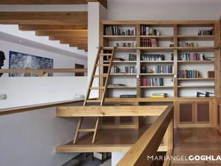 Biblioteca Estudios y despachos modernos de MARIANGEL COGHLAN Moderno
