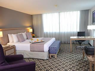 Habitación: Hoteles de estilo  por Factor Metro Cúbico