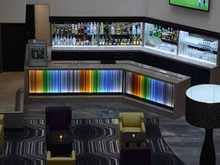 Lobby Bar: Hoteles de estilo  por Factor Metro Cúbico