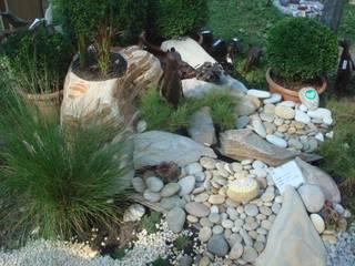 Jardines de estilo clásico de MM NATURSTEIN GMBH Clásico Piedra