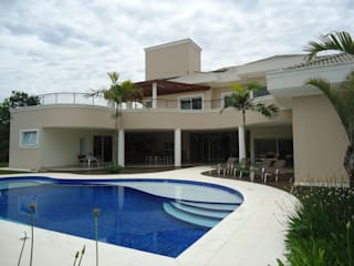 Modern houses by Arquidecor Projetos Modern
