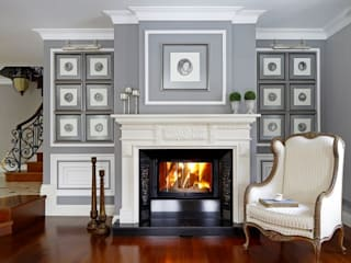 fireplace in the living room:   by ARKITEX INTERIORS
