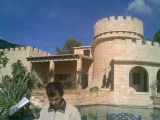 Viejo Molino Reformado Estilo Castillo.: Casas de estilo  de Balear de Reformas y Servicios Integrales 2012 S.L.