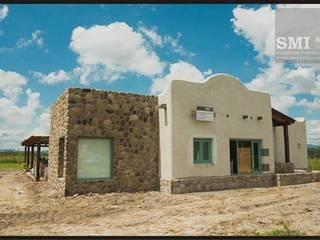 Casas de estilo  por SMI Arquitectura+Construcción