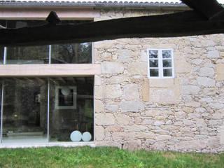 Rehabilitación de vivienda rural tradicional en Negreira - Brión Casas de estilo rural de Ezcurra e Ouzande arquitectura Rural