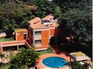 OMAR SEIJAS, ARQUITECTO Tropical style houses