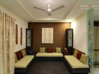A TRIPLEX VILLA NEAR SUNCITY, HYDERABAD:  Living room by KREATIVE HOUSE