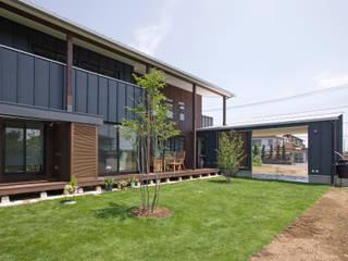 新田の家: 空間設計室/kukanarchiが手掛けた庭です。