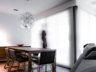 Modern dining room by XIMO ROCA DISEÑO Modern