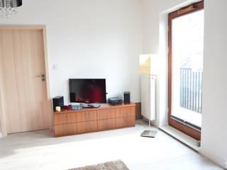 Nowoczesne mieszkanie singielki: styl , w kategorii Salon zaprojektowany przez Tetate Projektowanie Wnętrz