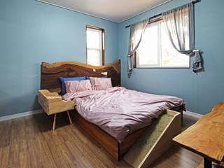 Dormitorios de estilo mediterráneo de 윤성하우징 Mediterráneo