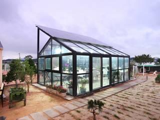썬룸에서 즐기는 따뜻한 햇살 [서산 부산리]: 윤성하우징의  주택,클래식