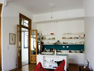 cocina con isla integrada al living Cocinas eclécticas de homify Ecléctico