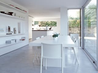 The dining area looking towards the kitchen at ​the Old Hall in Suffolk: modern Dining room by Nash Baker Architects Ltd